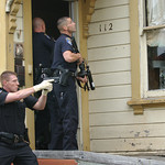 Mark McKenna/The Times-Standard Eureka Police Officer Alan Aubchon holds his gun drawn while Officer Gary Whitmer enters a house during  a search for Jay Xanadu Eddington. He was fleeing off ...
