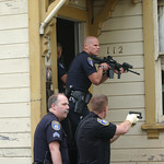 Mark McKenna/The Times-Standard Eureka Police Officers enter a house at 112 Del Norte during a search for Jay Xanadu Eddington. He was fleeing officers when he entered the house on across th ...