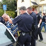 Mark McKenna/The Times-Standard Officers escort a handcuffed and shackled Jay Xanadu Eddington shortly after detaining him. He was fleeing officers when he entered a house on Del Norte Stree ...