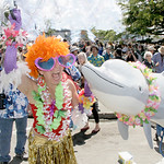 Shaun Walker/The Times-Standard  Kinetic groupie Lisa Powers of Cobb Mountain cheers next to the pod of dolphins on Team Melvin at the Kinetic Grand Championship in Arcata on Saturday.