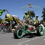 Shaun Walker/The Times-Standard  Visualize Whirled Peas, foreground, races with Gladys the Green Giraffe during the Kinetic Grand Championship in Arcata on Saturday.