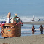 Jos� Quezada/For the Times-Standard  The Eureka Natural Foods Pic-a-Nic Basket, filled with organic food and people, lumbers down the Manila seashore with other kinetic machines before cros ...