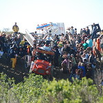 Jos� Quezada/For the Times-Standard  The crowd moves in for a closer look as the Hookah-n-Ladder from the Lost Coast Brewery fire department descends down Deadman's Drop in the Manila sand  ...