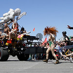 Shaun Walker/The Times-Standard  Kooky team members chase after Classical Nudes at the start of the Kinetic Grand Championship in Arcata on Saturday.